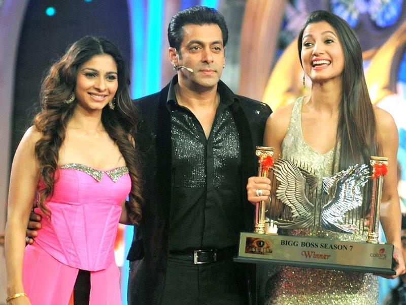 The winner takes it all: An elated Gauhar Khan with runner-up Tanisha Mukherji and Salman Khan.