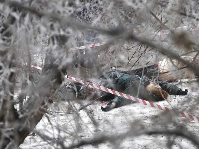 Victims' bodies lie outside a wreckage of a trolleybus in Volgograd, Russia. (AP Photo)