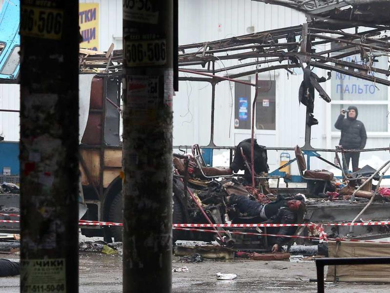 Dead bodies lie at the scene where a destroyed trolleybus stands on a street in Volgograd. Ten people were killed in a bombing on the packed vehicle, the second attack in the city in two days after a suicide strike on its main train station, officials said. (AFP Photo)
