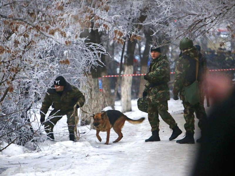 Police officers with a sniffing dog examine territory around the site of a trolleybus explosion in Volgograd. (AP Photo)