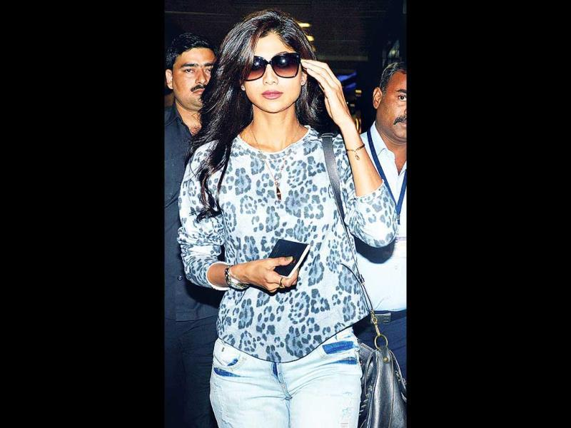 Shilpa Shetty looked fab in an animal-print top and casual jeans, as she left the airport on Sunday. (Photo: Yogen Shah)