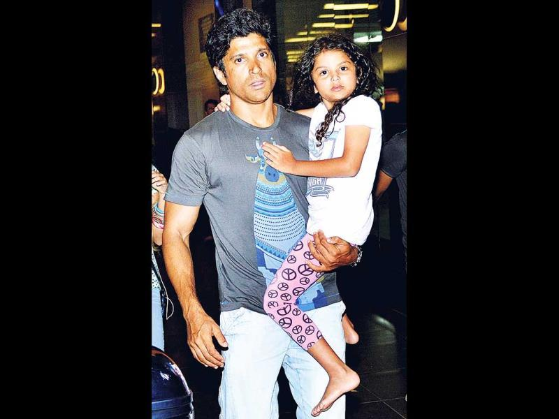 Farhan Akhtar was spotted with daughters Shakya and Akira (in the picture) at the Mumbai airport. (Photos: Yogen Shah)