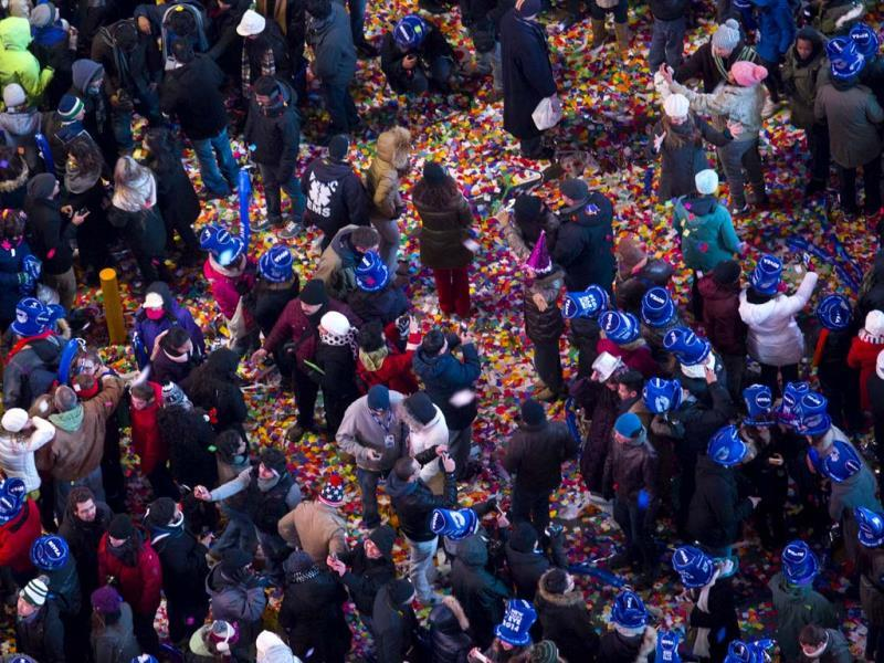 Confetti fills the streets in New York's Times Square as the new year is celebrated. (AP Photo)