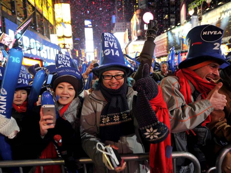 Thousands of revelers gather in New York's Times Square to celebrate the ball drop at the annual New Years Eve celebration (AFP Photo)