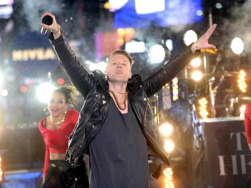 Artist Macklemore peforms as thousands of revelers gather in New York's Times Square to celebrate the ball drop at the annual New Years Eve celebration. (AFP Photo)
