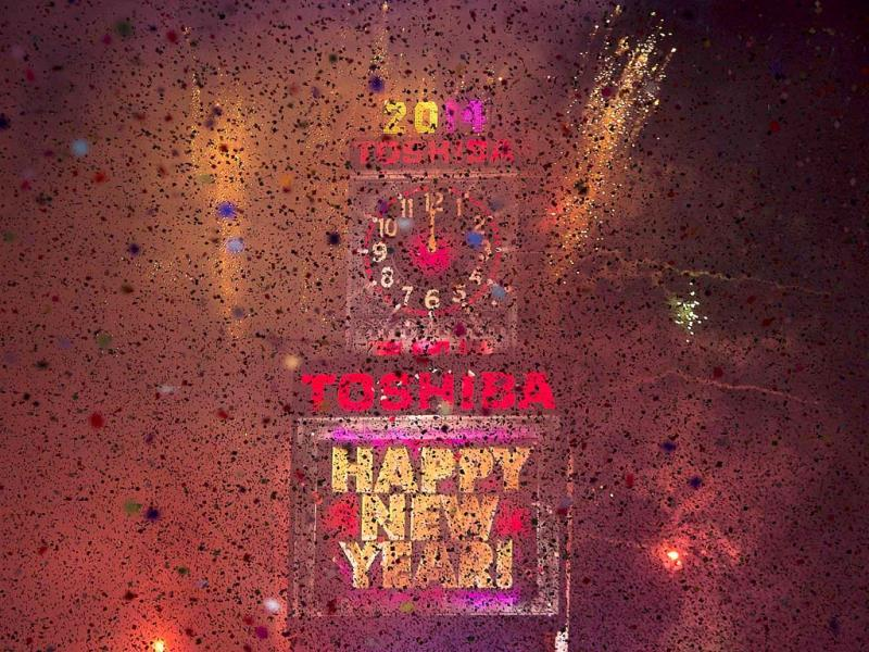 Fireworks go off at midnight on New Year's Eve in Times Square in New York. (Reuters Photo)