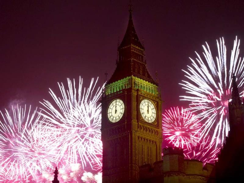 Fireworks explode over the Houses of Parliament, including Queen Elizabeth II tower which holds the bell known as Big Ben as London celebrates the arrival of New Year's Day. (AP Photo)