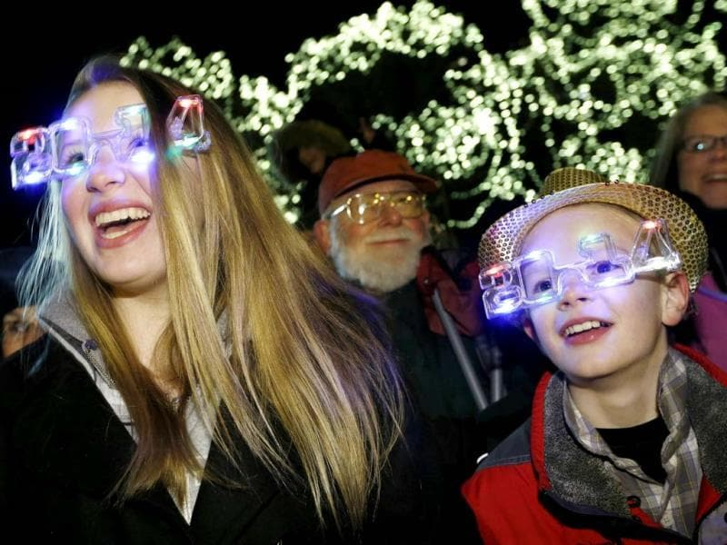 Georgia Woodcock, left, of Voluntown, Connecticut, and her brother Lucas take part in New Year's Eve celebrations in Boston. (AP Photo)