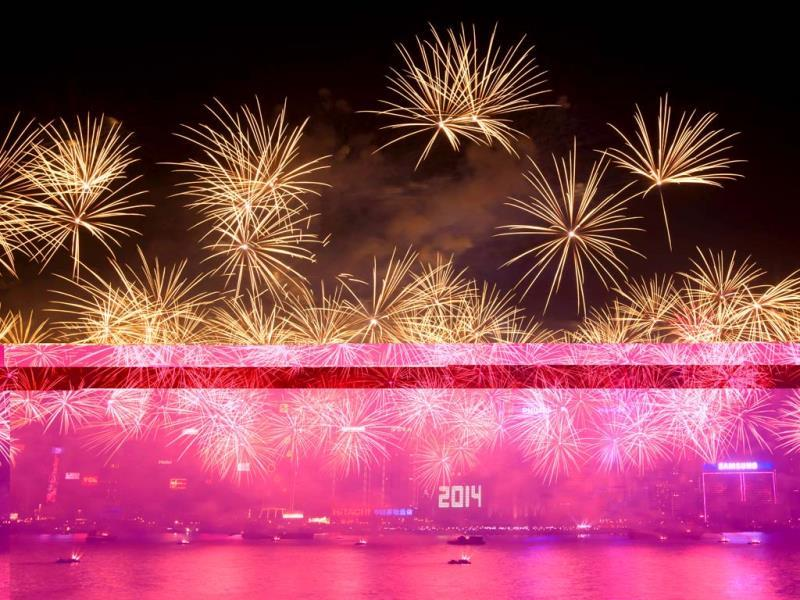 Fireworks explode over Victoria Harbour in Hong Kong. Hong Kong welcomed 2014 with a choreographed music and fireworks show. (AFP Photo)