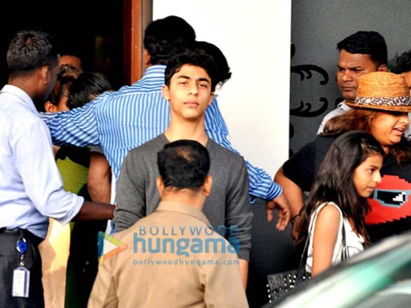 Aryan Khan seems to be guarding his brother from all the media frenzy.