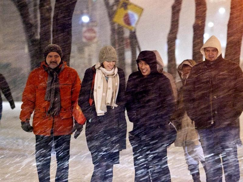 People walk through the snow during winter storm Hercules in lower Manhattan in New York City. (AFP photo)