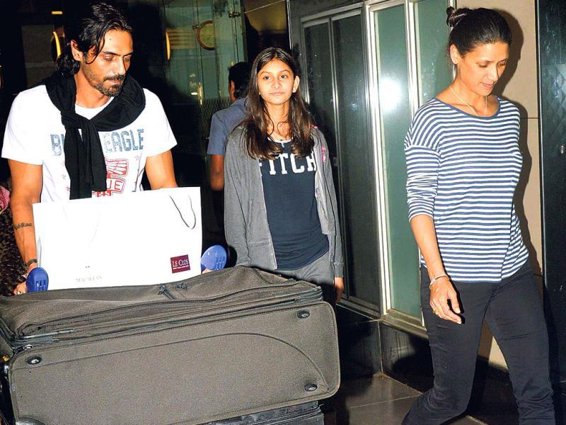 Arjun Rampal was spotted at the Mumbai airport with wife Mehr and daughter Mahikaa.