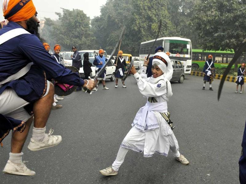 Sikh student shows their skill (Gatka) during Sikhs Procession carried out huge 'Nagar Kirtan' on the eve of Guru Gobind Singh ji Parkash Utsav 2014 in New Delhi. (HT Photo/Sonu Mehta)