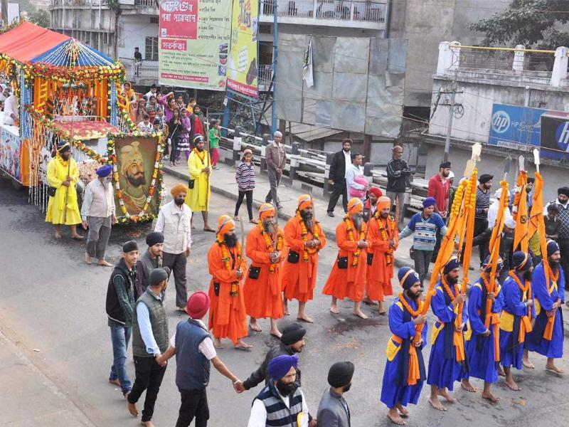 Sikh devotees take out a procession to mark Gurpurab on the birth anniversary of Guru Gobind Singh in Guwahati on Sunday. (PTI Photo)