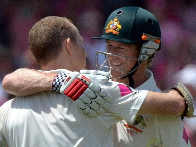 Australia's batsman George Bailey (R) hugs Chris Rogers (L) to congratulate him for his century against England on the third day of the fifth Ashes cricket Test. (AFP Photo)