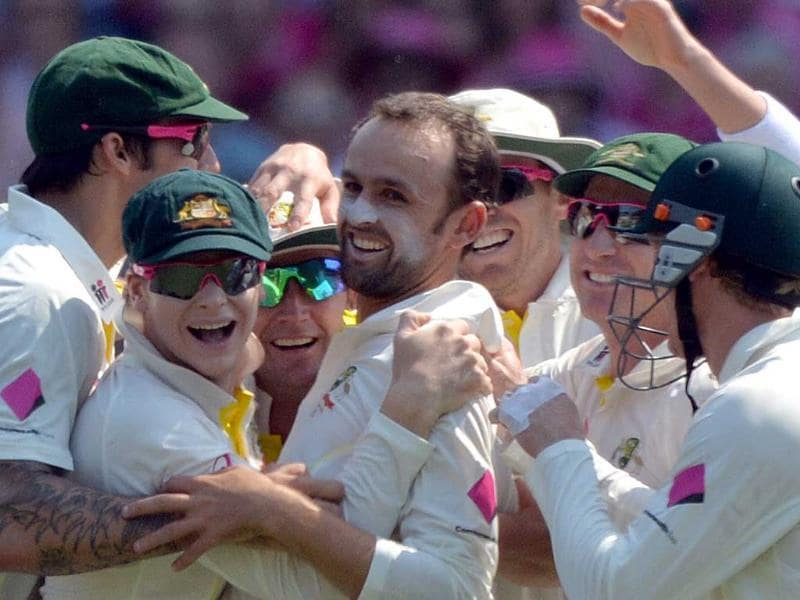 Australia's spin bowler Nathan Lyon (C) celebrates taking the wicket of England's batsman Scott Borthwick with teammates on the third day of the fifth Ashes cricket Test at the Sydney Cricket Ground. (AFP Photo)