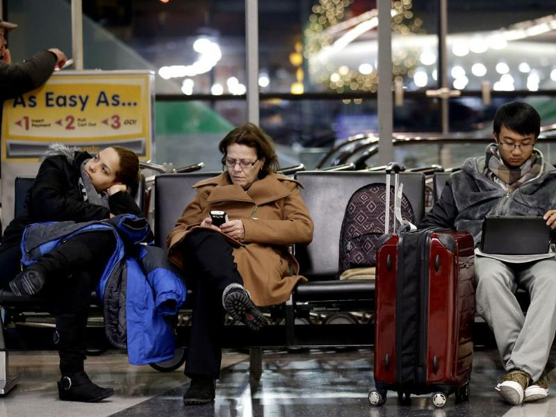 Travelers deal with long waits and flight cancellations at O'Hare International Airport in Chicago. (AP Photo)