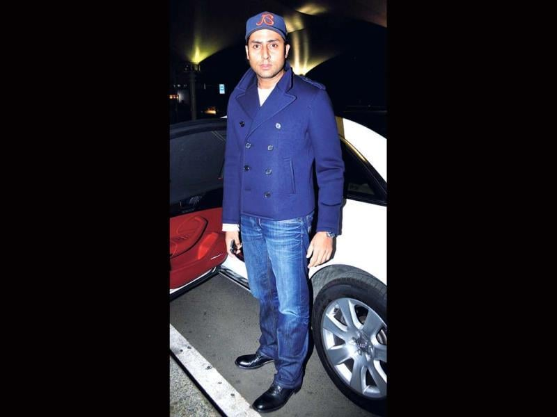 Abhishek Bachchan makes a statement in his winter wear at Mumbai airport
