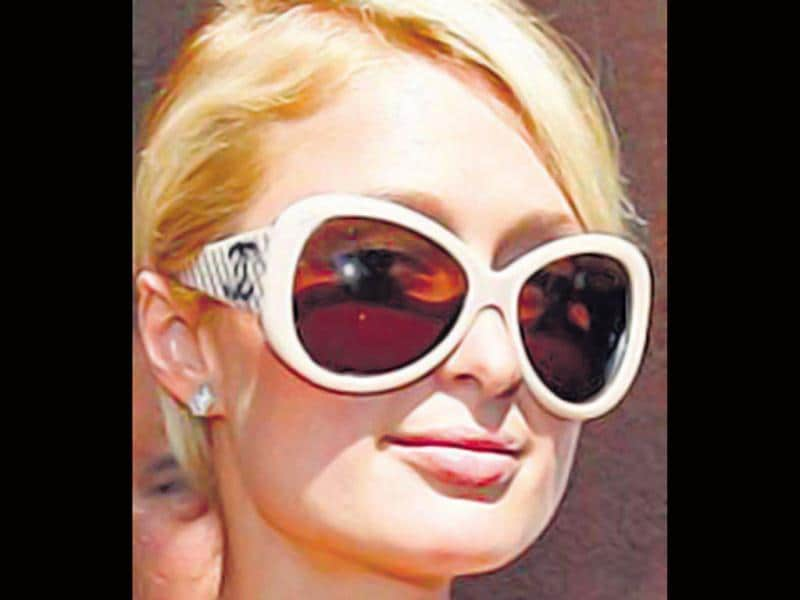 Paris Hilton pulls off the large shades look in a classy way.
