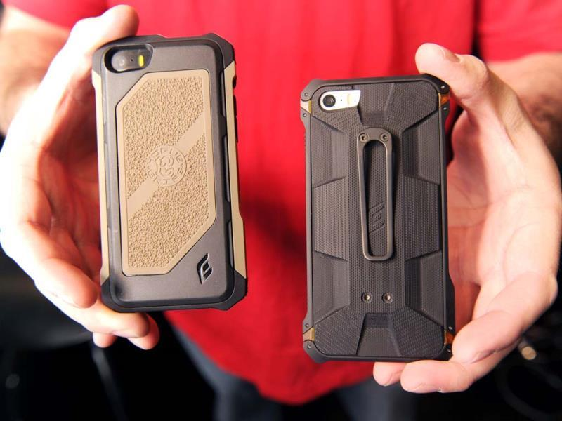 The Rogue Black Ops iPhone case (L) and the Sector 5 Black Ops Elite iPhone case (R) are displayed at the 2014 International CES in Las Vegas, Nevada. (AFP Photo)