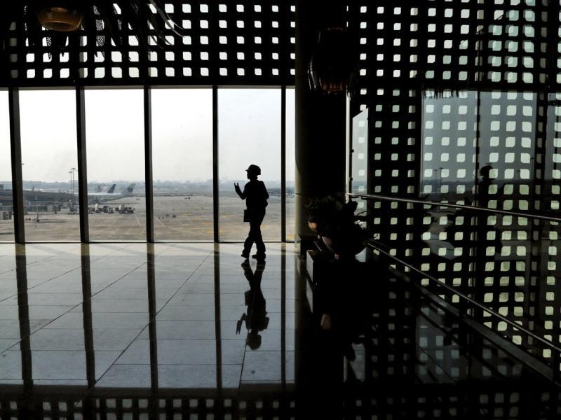 A worker walks inside the new airport terminal at the Chhatrapati Shivaji International Airport in Mumbai, India. AP