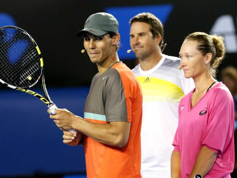 Spain's Rafael Nadal (L) stands with Australia's Pat Rafter and Samantha Stosur during an exhibition match on Kids Tennis Day ahead of the Australian Open. (AP Photo)