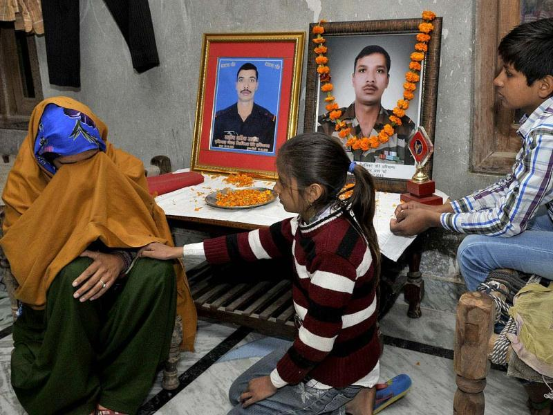 Bharti Devi, Sangwan's wife, being consoled by daughter Anu (9) as son Ankit (11) looks on. Sushil Kumar/HT Photo