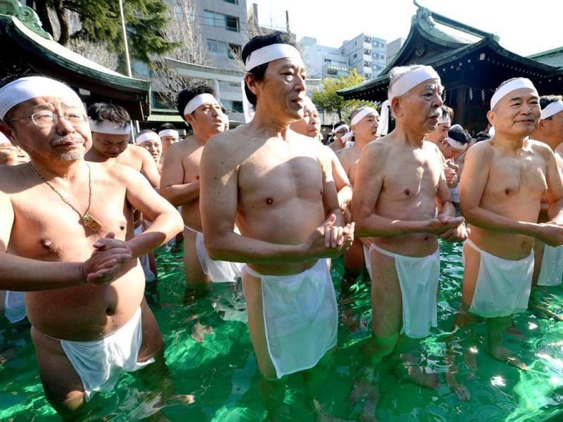 People soak in cold water to purify their bodies and souls during the annual purification event, where some 100 people took part. (AFP)
