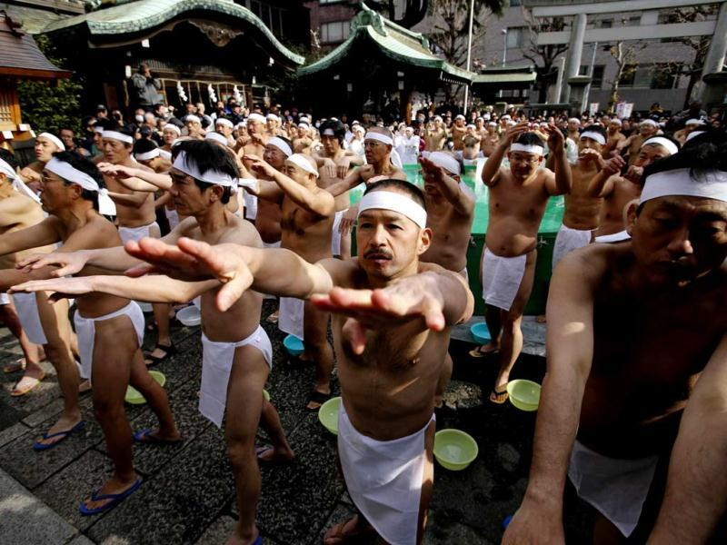 Men wearing loincloths warm up before bathing in ice-cold water during a Shinto ceremony to purify their souls and wish for good health in the new year. (Reuters)