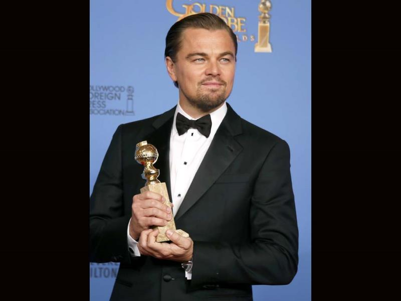 Leonardo DiCaprio poses with the award for Best Actor in a Motion Picture, Musical or Comedy for his role in The Wolf of Wall Street. (Reuters Photo)
