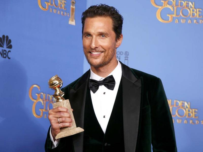 Actor Matthew McConaughey poses backstage with his award for Best Actor in a Motion Picture, Drama for his role in