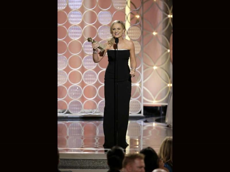 Actress Amy Poehler holds her award for Best Actress - TV Series, Comedy or Musical, for