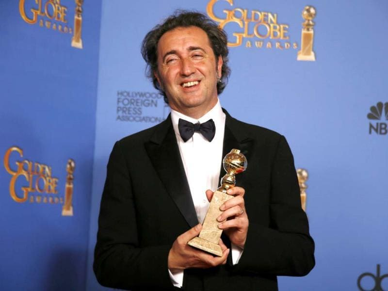 Producer Nicola Giuliano poses backstage with the award for Best Foreign Language Film for