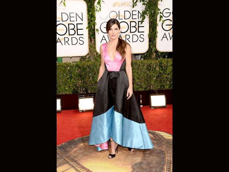 Nominated for Gravity, Sandra Bullock carried that sci-fi look too far. She wore a dress with too many colours -- blue, pink and black and it was A-line!