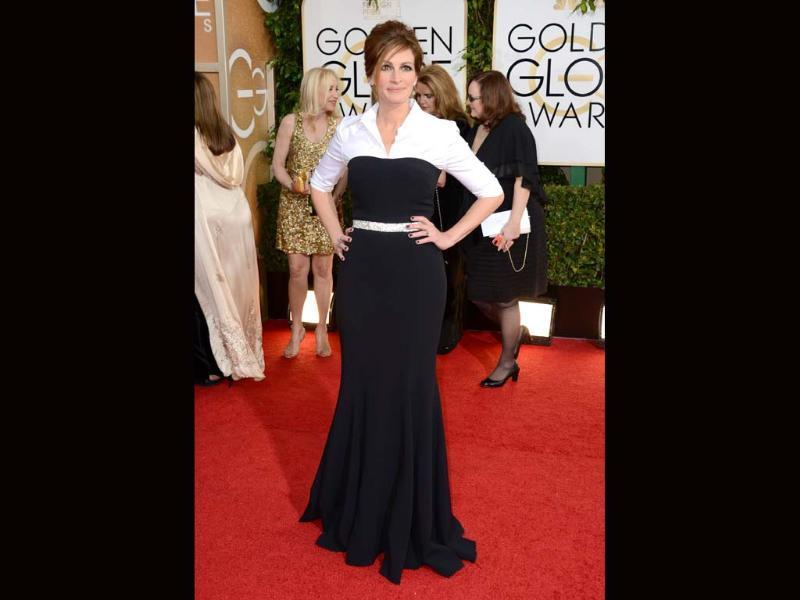 Otherwise perfectly dressed Julia Roberts missed this once. She chose a black-and-white belted dress from Dolce and Gabbana which made her look like a secretary. A well dressed secretary, though.