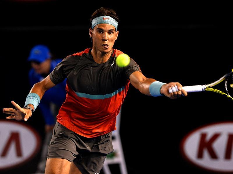 Spain's Rafael Nadal plays a shot during his men's singles match against Australia's Bernard Tomic on day two of the 2014 Australian Open in Melbourne. (AFP Photo)