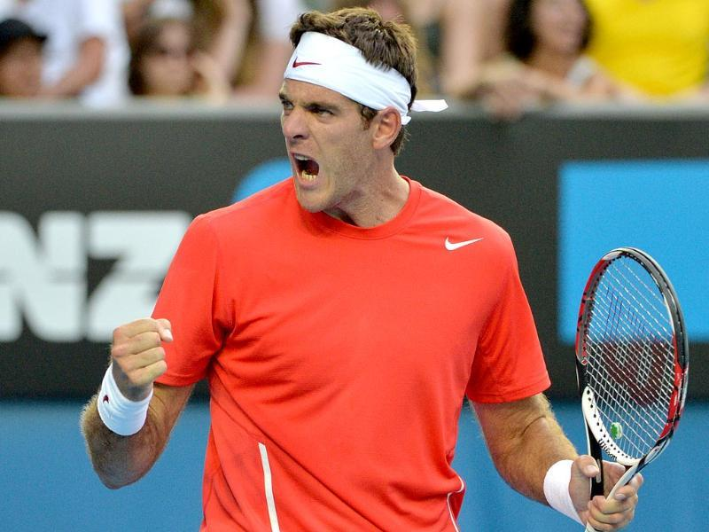 Argentina's Juan Martín Del Potro reacts during his men's singles match against Rhyne Williams of the US on day two of the 2014 Australian Open in Melbourne. (AFP Photo)