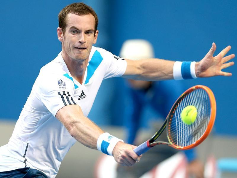 Andy Murray of Britain returns to Go Soeda of Japan in their first round match at the Australian Open in Melbourne. (AP Photo)