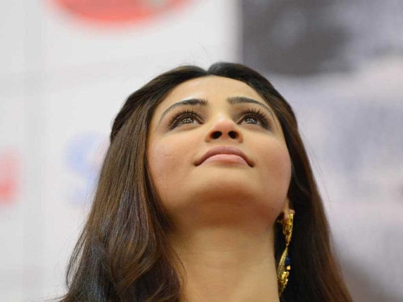 Daisy Shah looks up while talking to media during a promotional event for the film 'Jai Ho' at a kite festival on the outskirts of Ahmedabad on January 14, 2014. (AFP Photo)