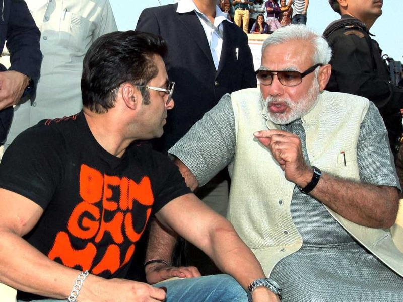 Gujarat chief minister Narendra Modi with Bollywood actor Salman Khan during the Uttarayan Festival in Ahmedabad on Tuesday. (PTI Photo)
