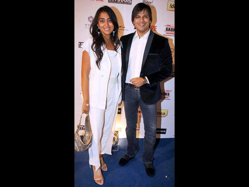 Vivek Oberoi and his wife pose together.