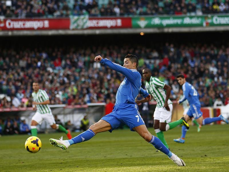 Real Madrid Cristiano Ronaldo tries to control a ball during their Spanish First Division soccer match against Real Betis at the Benito Villamarin stadium in Seville. REUTERS
