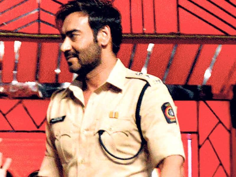Ajay Devgn in khaki as he performs at the event.