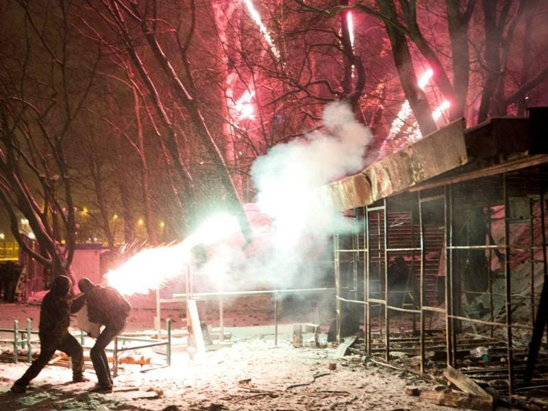 Protesters use fireworks during clashes with police in central Kiev, Ukraine. (AP Photo)