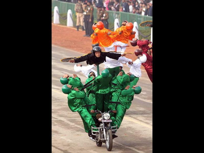 BSF daredevils in action during the full dress rehearsal for the Republic Day parade in New Delhi. (PTI photo)