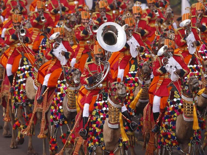 BSF personnel, mounted on camels, used to secure the India-Pakistan border along the deserts of Rajasthan, play wind instruments during full dress rehearsals for the Republic Day parade in New Delhi. (AP photo)