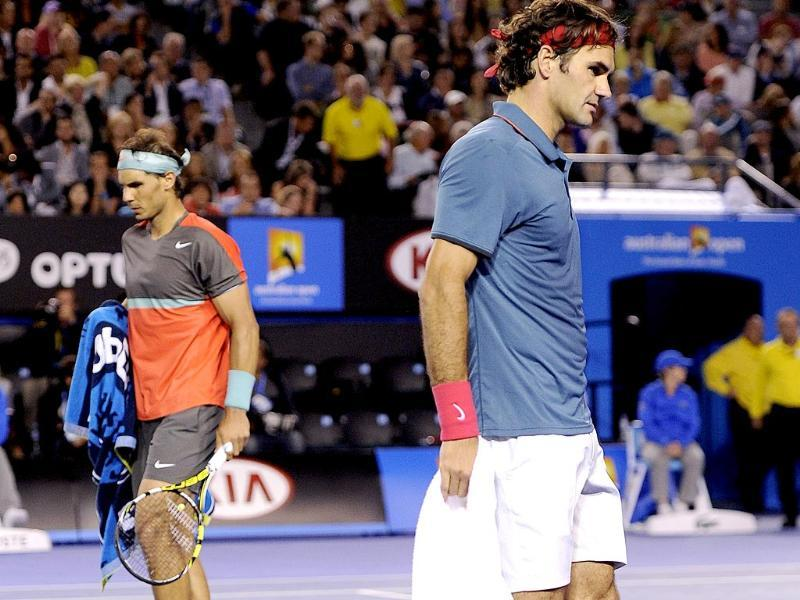 Roger Federer of Switzerland (R) and Rafael Nadal of Spain walk during the change of end in their semifinal at the Australian Open in Melbourne. (AP Photo)