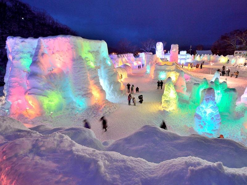 People enjoy at the Chitose-Lake Shikotsu Ice Festival illuminated by colorful light to produce a fantastic world in Chitose. (AFP)