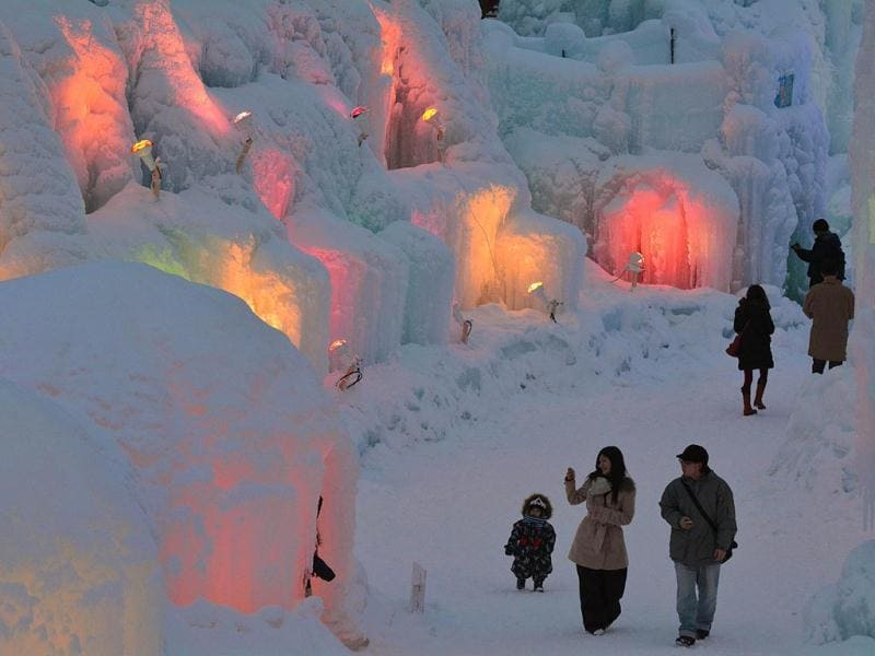 People visit the Chitose-Lake Shikotsu Ice Festival illuminated by colorful light to produce a fantastic world in Chitose. (AFP)