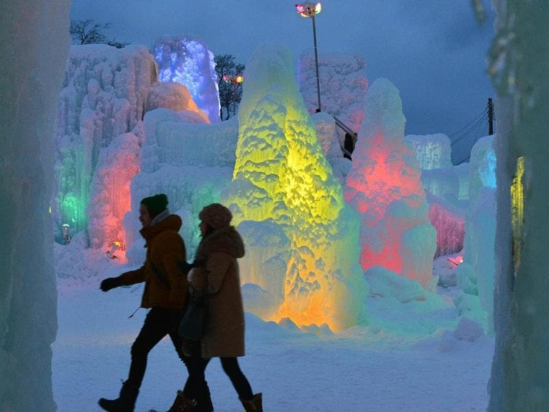 A couple visit the Chitose-Lake Shikotsu Ice Festival in Chitose, Japan. (AFP)